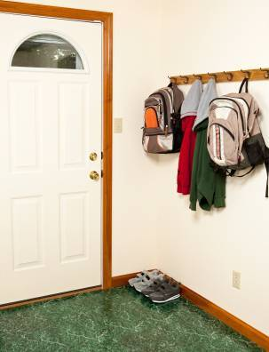 Backpacks and Jackets Hanging by the Backdoor