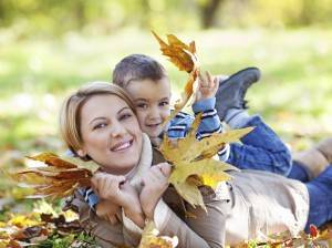 Mother and son enjoying autumn in park